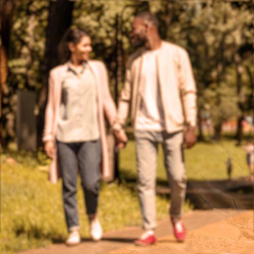 Blurred Image Of Couple Walking Outside