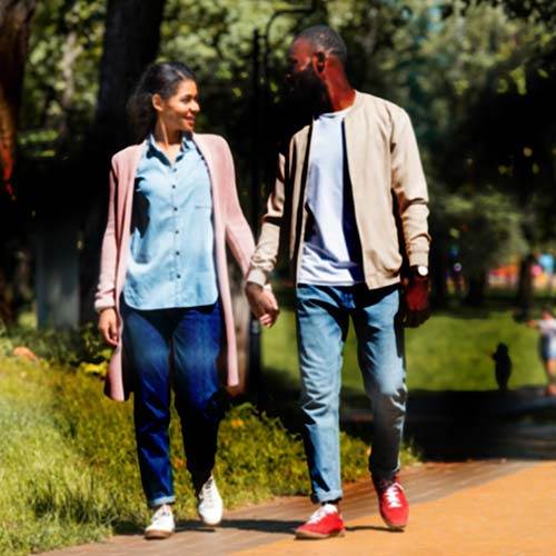 Varying Shades Distorting Image Of Couple Walking Outside